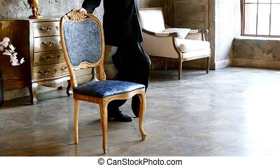 Man and chair, tango dance indoors