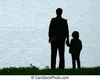 Man and child silhouette at evening - Man and child...