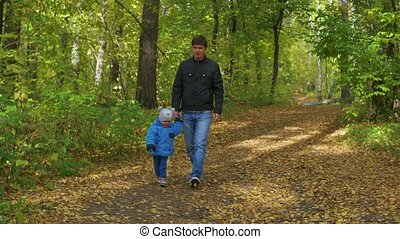 Man and child walking in the Park