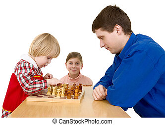 Man and childs play chess