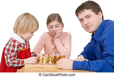 Man and childs play to chess