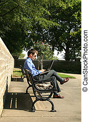 Man and Computer at Park