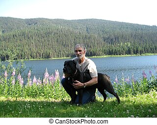 Man and dog by the lake