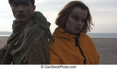 Man and Girl in cloudy wasteland. Stalker - Survival...