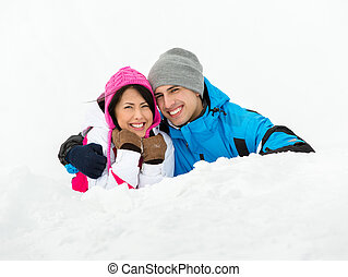 Man and girl lying in snow