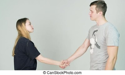 Man and girl shaking hands on white background. Closeup...