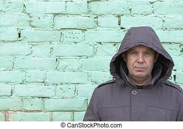 man and green wall