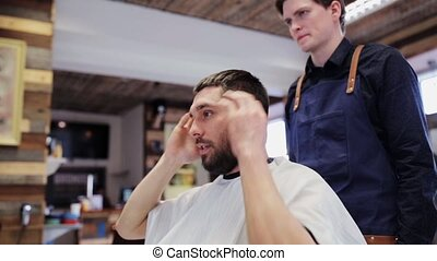 man and hairstylist or hairdresser at barber shop - beauty,...