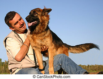 man and happy dog - man and his purebreed german shepherd