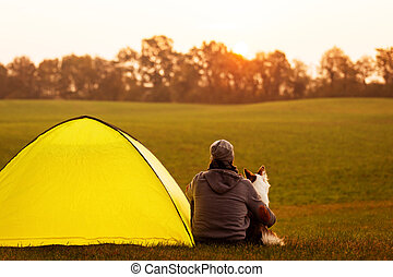 Man and his dog are camping in the nature, dogcamping
