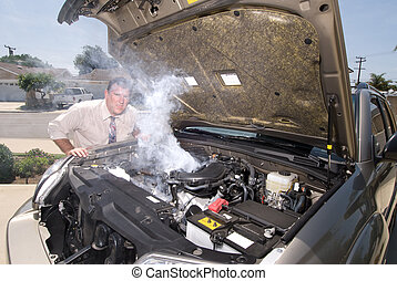 Man and his over heated car - A man is very frustrated and ...