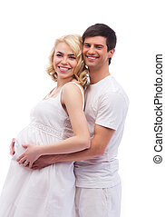 Man and his pregnant wife isolated on white