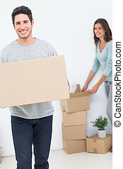 Man and his wife moving in a new house