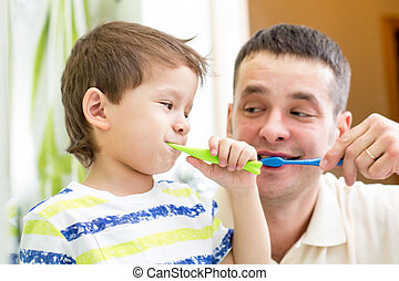 man and kid boy brushing teeth in bathroom