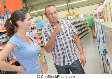 Man and lady in hardware store