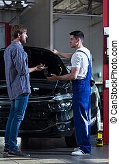 Man and mechanic at workshop