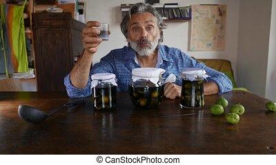 Nocino Jars Italian liquor - Man and Nocino Jars Italian ...