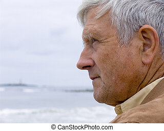 Man and Ocean - Elderly man lookingo out over the ocean