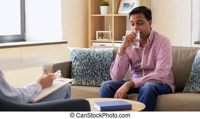 man and psychologist at psychotherapy session - psychology, ...