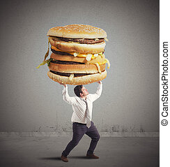 Man and sandwich weight - Fat man supports the weight of...