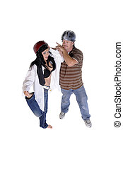 man and sexy woman playing around with helmets on their heads