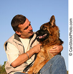 man and shepherd - cool man and his purebreed german...