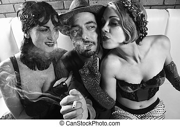 Man and two women. - Caucasian prime adult retro male...