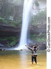 man and waterfall
