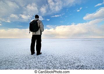 Man and winter plain. Conceptual scene.