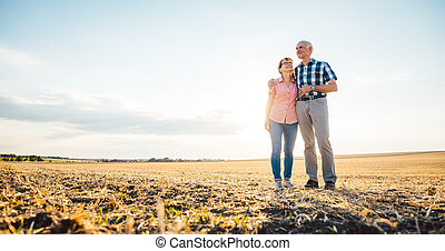 Man and woman, a senior couple, embracing each other
