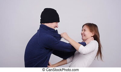 Man and woman are fighting. Terrible domestic violence in...