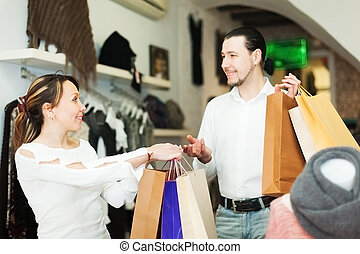 Man and woman at clothing boutique