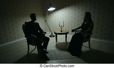 Man and woman at dark room - Young couple quarrels. Offended...