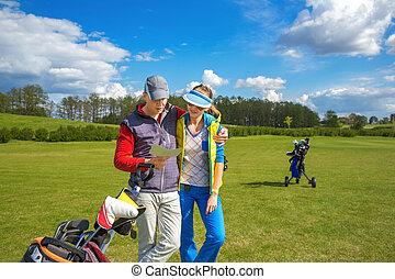 Man and woman at golf