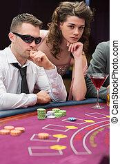 Man and woman at poker table