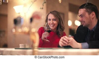 Man and woman at the bar counter