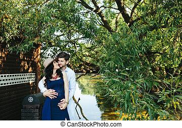 man and woman at the lake