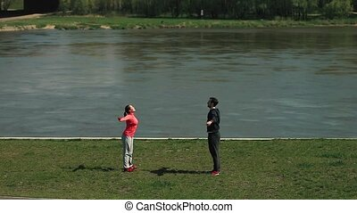 Man and Woman Athlete Practicing, Playing Sports and Yoga on...