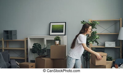 Man and woman bringing boxes with personal things moving in to new house