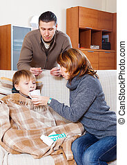 Man and woman caring for sick boy