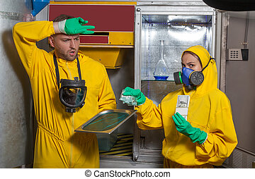 Man and woman cooking meth - Man and woman in protective...