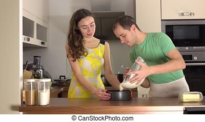 Man and woman cooking together at home
