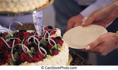 Man and woman cutting celebration cake