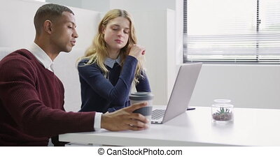 Man and woman discussing at the office