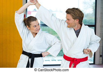 man and woman doing karate