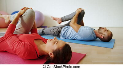 Man and woman doing leg stretching exercise 4k