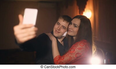 man and woman doing selfie smartphone on the evening in cafe romantic love   lifestyle