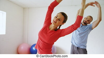 Man and woman doing stretching exercise 4k