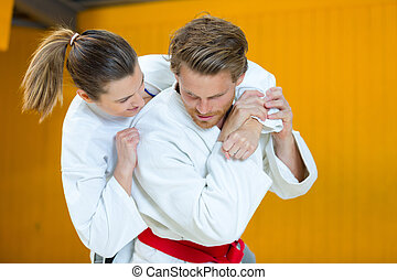 man and woman during karate training