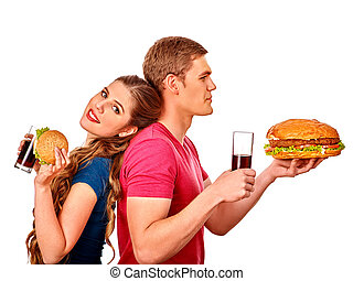 Man and woman eating big sandwich with cola. Isolated. -...
